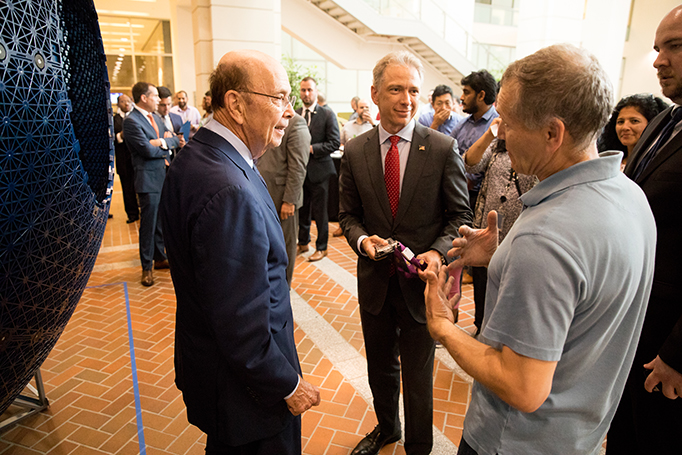 Secretary Ross and Director Iancu speak with the inventor of the Virtusphere, Ray Latypov