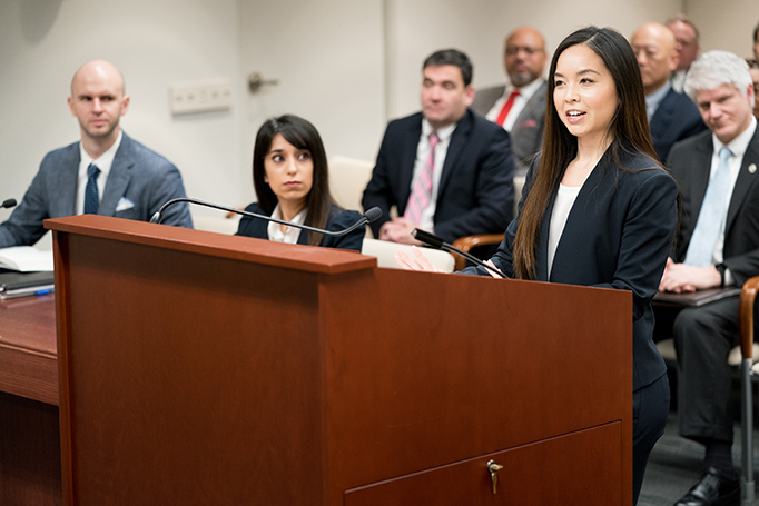 A female law clerk makes a mock argument before the PTAB.
