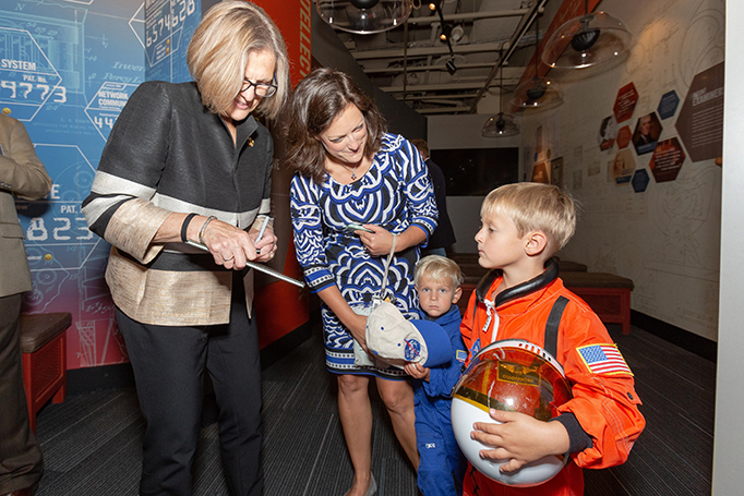 Astronaut and first woman to walk in space Dr. Kathryn Sullivan meets children of Ian Steff, Deputy Assistant Secretary for Manufacturing, International Trade Administration.