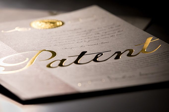 "A photo of the newly redesigned patent cover, featuring the word ""patent"" inscribed in gold leaf lettering."