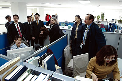 Photo showing Under Secretary Dudas touring an examiner's office in China.