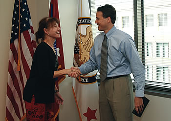 Photo showing Under Secretary Dudas congratulating Commissioner for Trademarks Lynne Beresford after swearing her in.