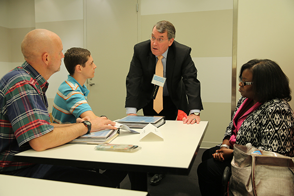 USPTO employees work with outside experts to talk one on one with attendees.
