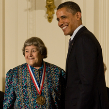 Yvonne C. Brill poses with President Barack Obama