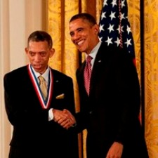 George Carruthers shakes hands with President Barack Obama