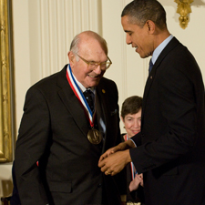 Harry Coover shakes hands with President Barack Obama