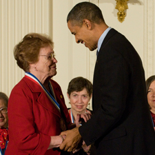Helen Free shakes hands with President Barack Obama