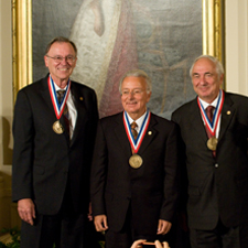 Federico Faggin; Marcian E. Hoff, Jr.; and Stanley Mazor shake hands with President Barack Obama