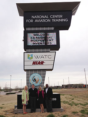 USPTO employees standing in front of sign for National Center for Aviation Training