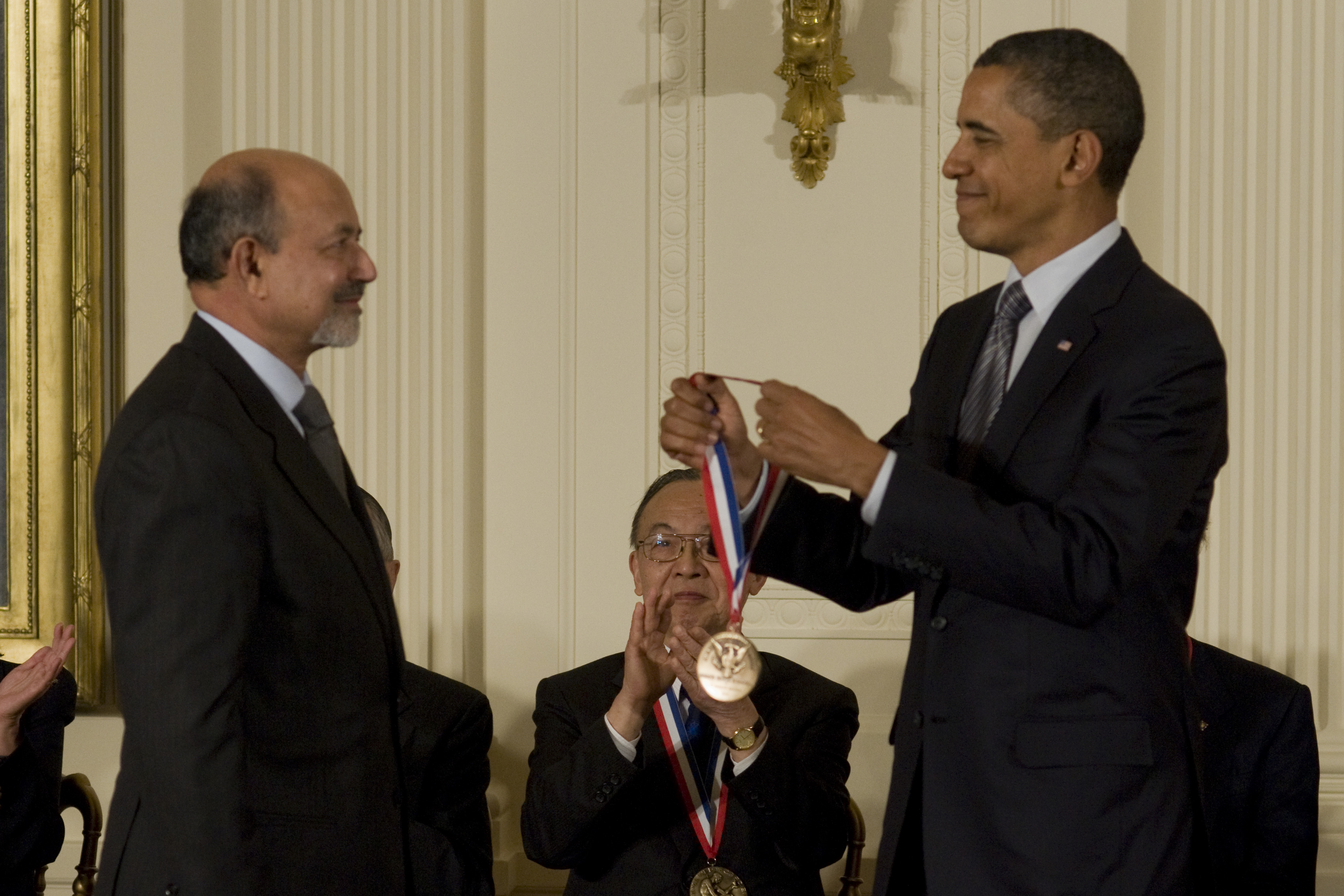 Jayant Baliga receives medal from President Obama