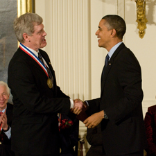 Steven Sasson shakes hands with President Barack Obama