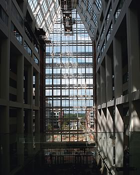 Photo showing the USPTO building atrium from the inside looking out.