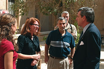 Photo showing Linda Lourie, USPTO attorney-advisor, talking with Paul Bremer, then head of the Coalition Occupational Authority, during her assignment in Iraq where she worked with Iraqi officials on issues related to their intellectual property system.