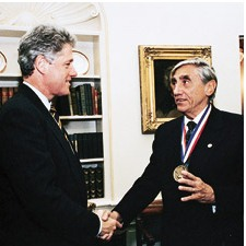 H. Joseph Gerber shakes hands with President Bill Clinton