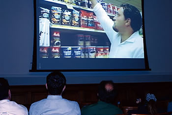 Photo showing Congressional staff members screening the geographical indications video produced last year by the USPTO and the Department of Agriculture.