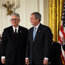 Adam Heller stands beside President George W. Bush