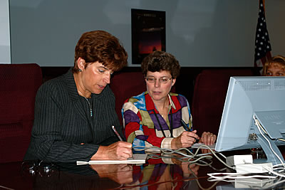 Photo showing USPTO experts reviewing and responding to questions during an Inventors Online discussion.