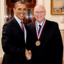 Norman McCombs shakes hands with President Barack Obama