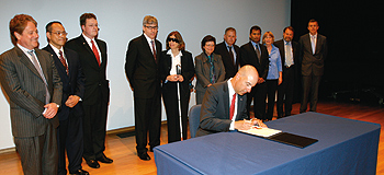 Photo showing Under Secretary Kappos signing Patent No. 8,000,000 at a signing ceremony at the Smithsonian American Art Museum, once the home of the first U.S. Patent Office, August 16, 2011.