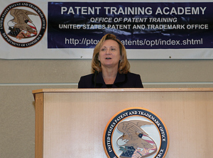 Photo showing Deputy Director of the USPTO Teresa Stanek Rea speaking at the Patent Training Academy's May graduation in Alexandria, Virginia.