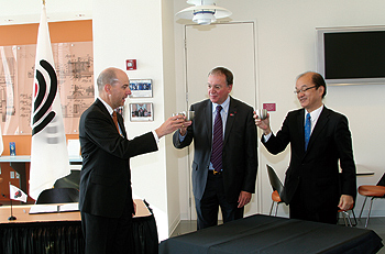 Photo showing Under Secretary Kappos, Japan Patent Office Commissioner Yoshiyaki Iwai, and President of the European Patent Office Benoît Battistelli celebrating further work sharing agreements, November 14, 2010, in Alexandria, Virginia.