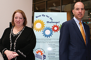 Photo showing Chief Administrative Officer Patricia Richter and Under Secretary David Kappos supporting the USPTO's Creativity Challenge, which asked employees for ways they would improve Agency processes.