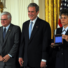 Representative from Skunk Works stands beside President George W. Bush