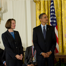 Esther Sans Takeuchi stands beside President Barack Obama