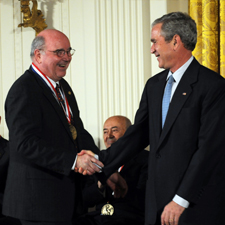 Carlton Grant Willson shakes hands with President George W. Bush
