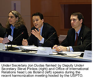 Under Secretary Jon Dudas flanked by Deputy Under Secretary Steve Pinkos (right) and Office of International Relations head Lois Boland (left) speaks during the recent harmonization meeting hosted by the USPTO