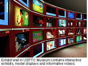 Exhibit wall in USPTO Museum contains interactive exhibits, model displays and informative videos