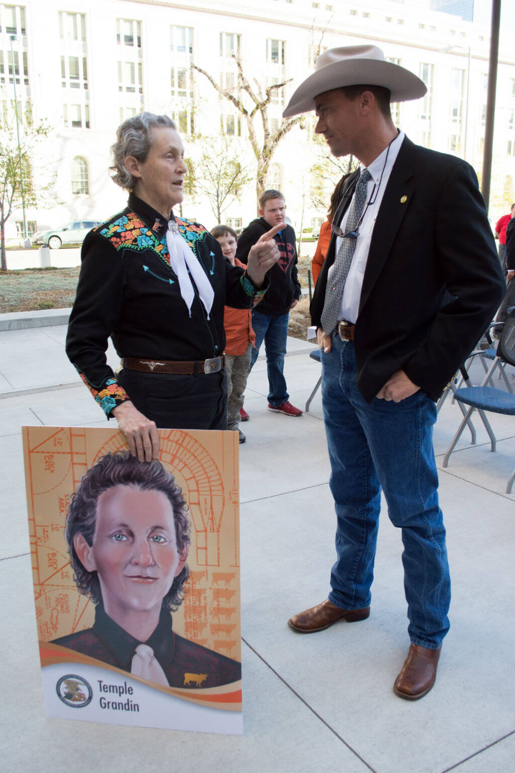 Image: Grandin with her USPTO inventor trading card, presented to her in 2016 at the USPTO Rocky Mountain Regional Office in Denver, Colorado.