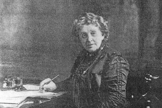 Image: Portrait of Josephine Cochran in middle age, seated at a desk.