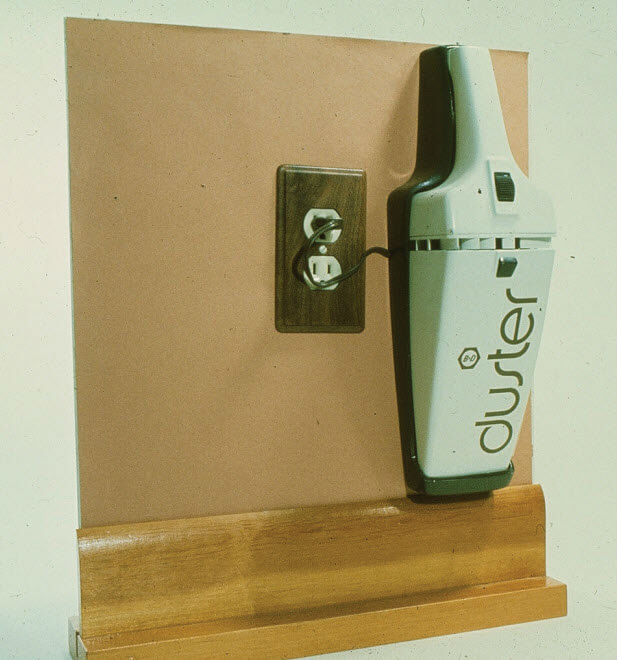Image: A later prototype for the Dustbuster, showing it plugged into a wall