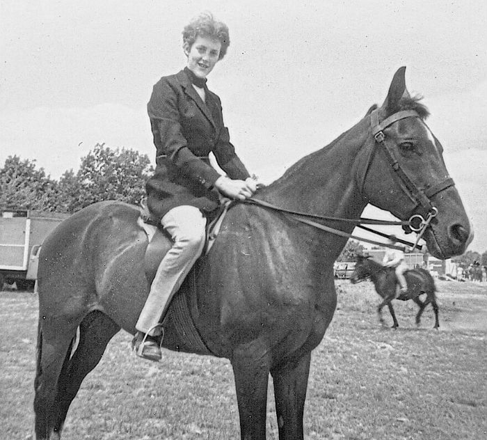 Image: Black and white photo of Temple Grandin on horseback as a teen.