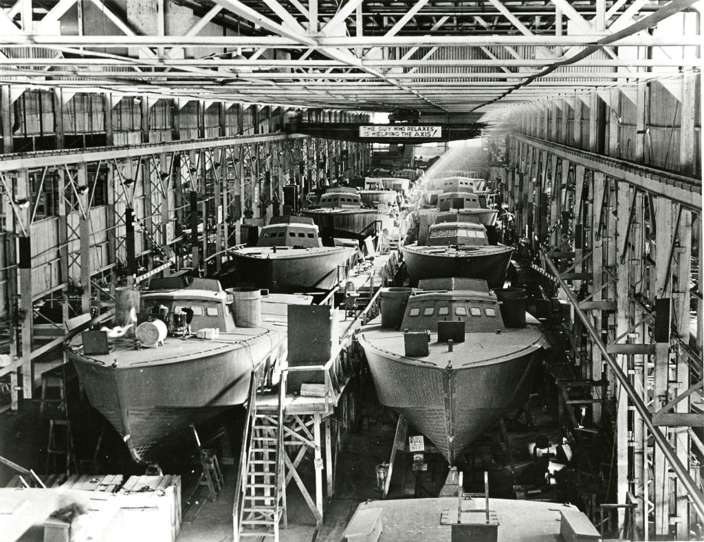 Image: the Higgens factory floor bustles with boatbuilding activity
