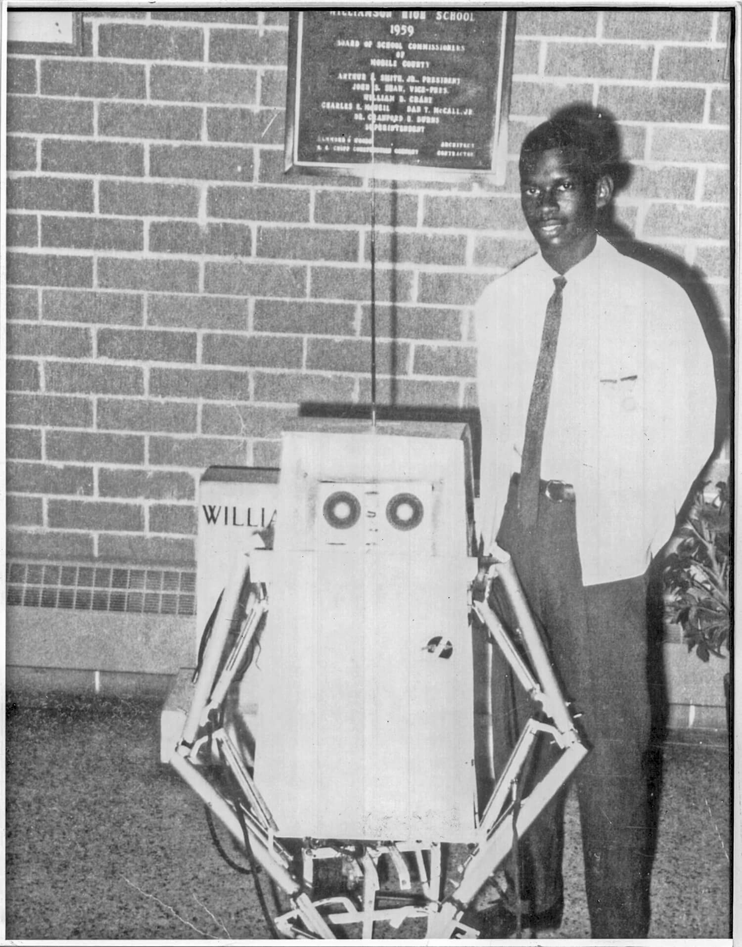 Image: Lonnie Johnson with the robot he built in high school