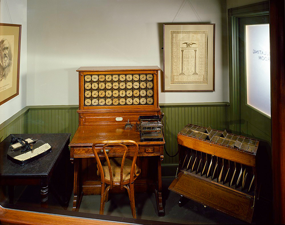 Museum exhibit of a Hollerith card puncher, tabulator, and sorting box