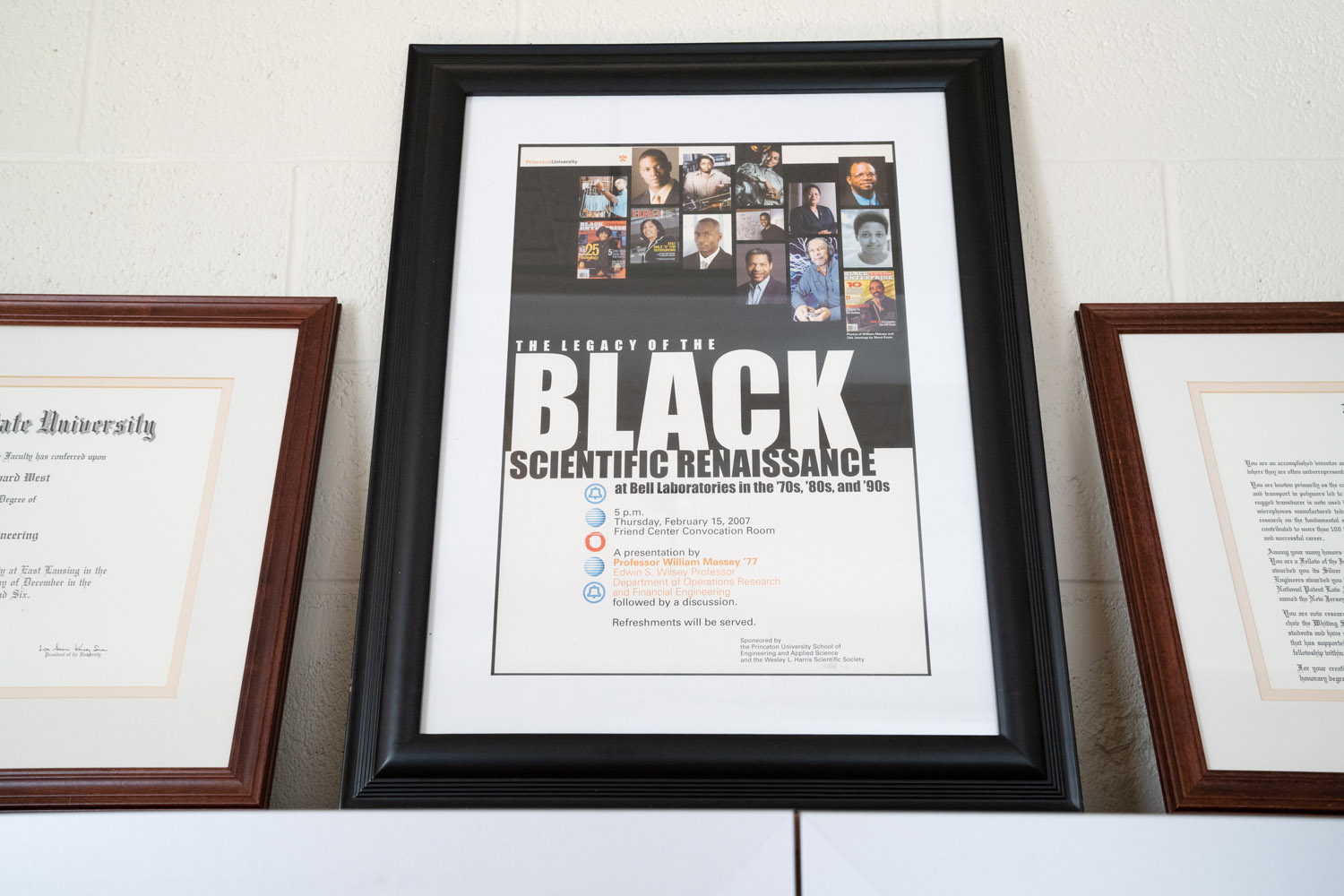 A framed announcement of an event in which Jim West was honored.
