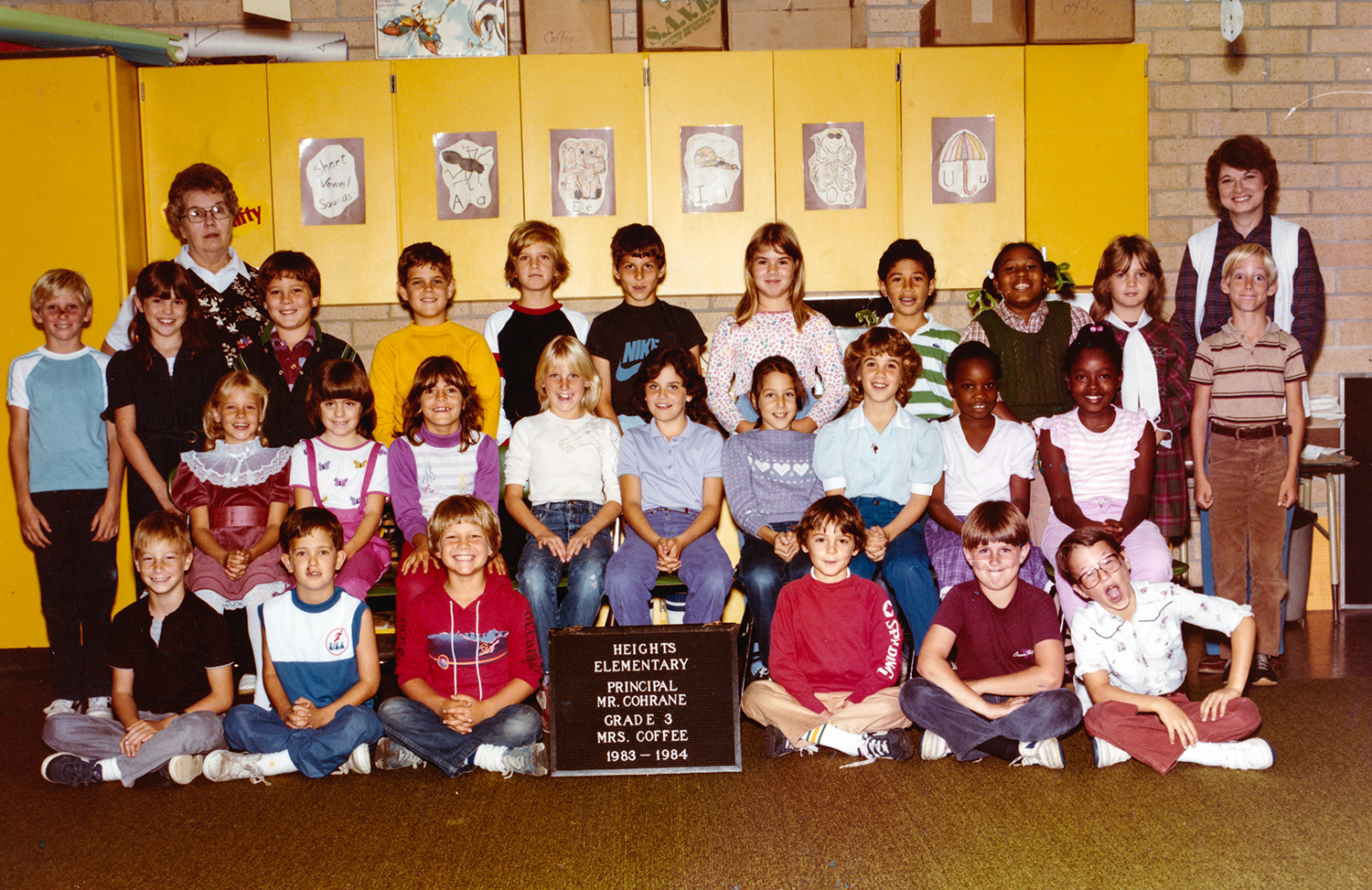 Susann Keohane, in the back, second from right standing directly next to her third grade teacher Mrs. Coffee, back right, and her third grade class in an old school photo.