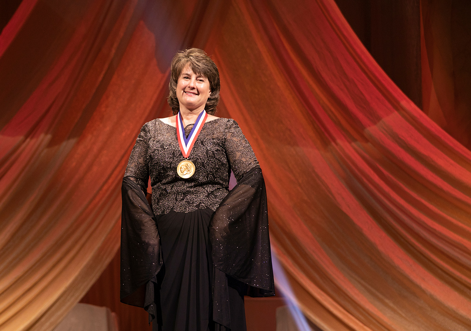 Jackie Quinn smiles with a medal on at the 2018 National Inventor Hall of Fame Induction Ceremony