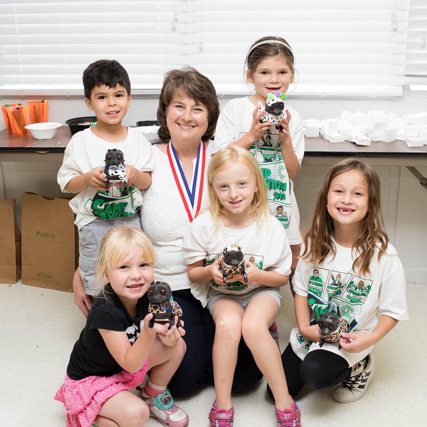 Jackie Quinn poses with Camp Invention kids