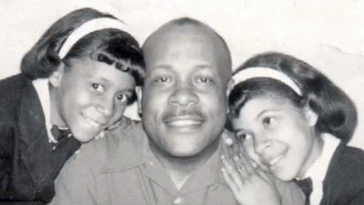 Marian Croak smiles as a child with her father and sister