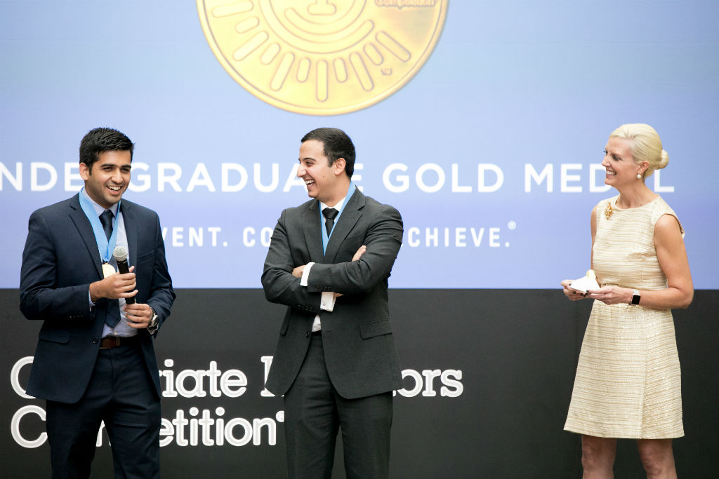 Ameer Shakeel (left) and Payam Pourtaheri (center) accept the 2016 National Inventors Hall of Fame Collegiate Inventors Competition undergraduate gold medal at the USPTO.