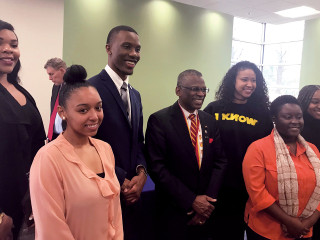 Lonnie Johnson surrounded by attendees at USPTO's Black History Month Celebration at Clark Atlanta University