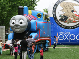 Different characters and mascots at the trademark expo including Thomas the Tank Engine