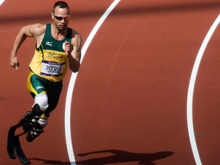 "Oscar Pistorius, running with his special carbon fiber ""blade"" prosthetics"