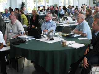 Attendees at one of the USPTO's regional Independent Inventors Conferences gathered together at a table
