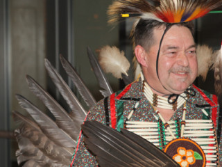 Brad Rousseau, an enrolled member of the Turtle Mountain Chippewa tribe from North Dakota dressed in his traditional tribe attire