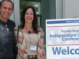 Florida Regional Independent Inventors Conference over the weekend of April 27-28 sign with people posing next to it